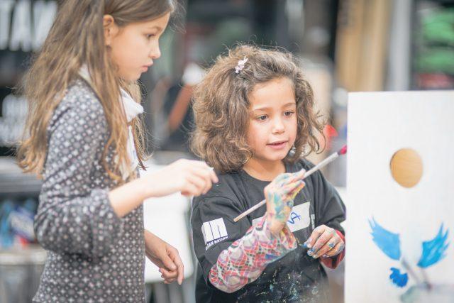 Kids painting birdhouse