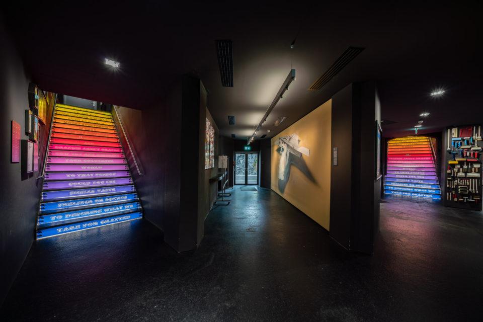 Ben Eine stairs URBAN NATION Museum