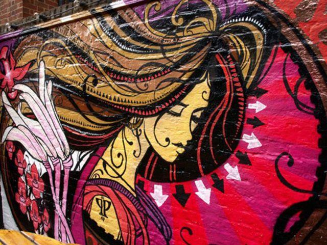 Inkie painting graffiti artist