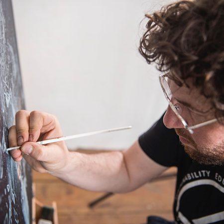 Artist Onur painting